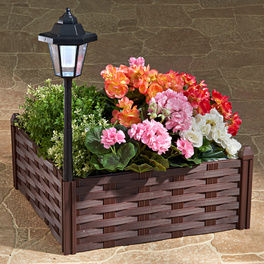 Bac à fleurs avec lanterne solaire