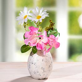 Fleurs dans un pot en forme d'œuf