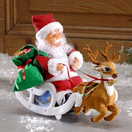 Père Noël en traîneau avec musique
