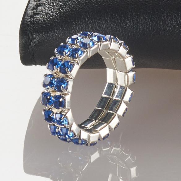 Bague élastique,  coloris argenté à strass  couleur saphir