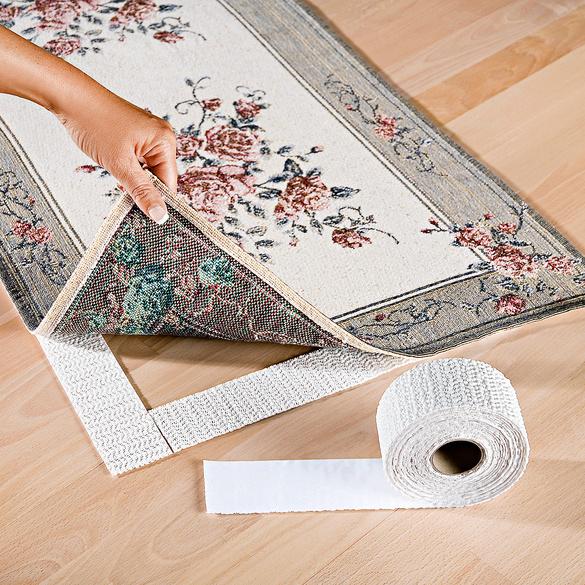 Bande de fixation pour tapis