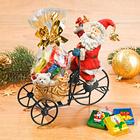 Père Noël en tricycle avec chocolats