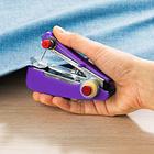 Machine à coudre manuelle, violet