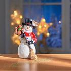 Bonhomme de neige avec balai